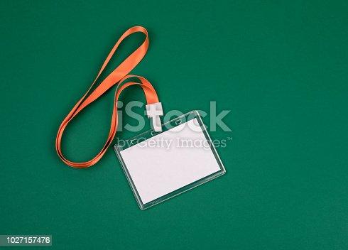 1049305186istockphoto empty staff identity mockup with orange lanyard 1027157476