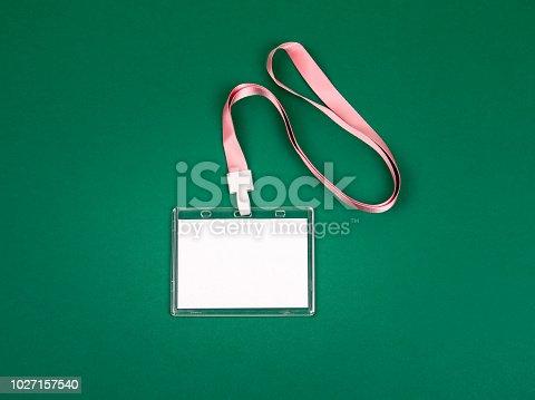 1049305186istockphoto empty staff identity mockup with pink lanyard 1027157540