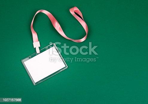 1049305186istockphoto empty staff identity mockup with pink lanyard 1027157568