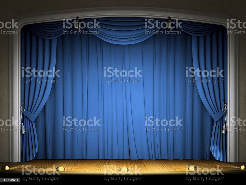 Empty stage with blue curtain in expectation of performance stock photo