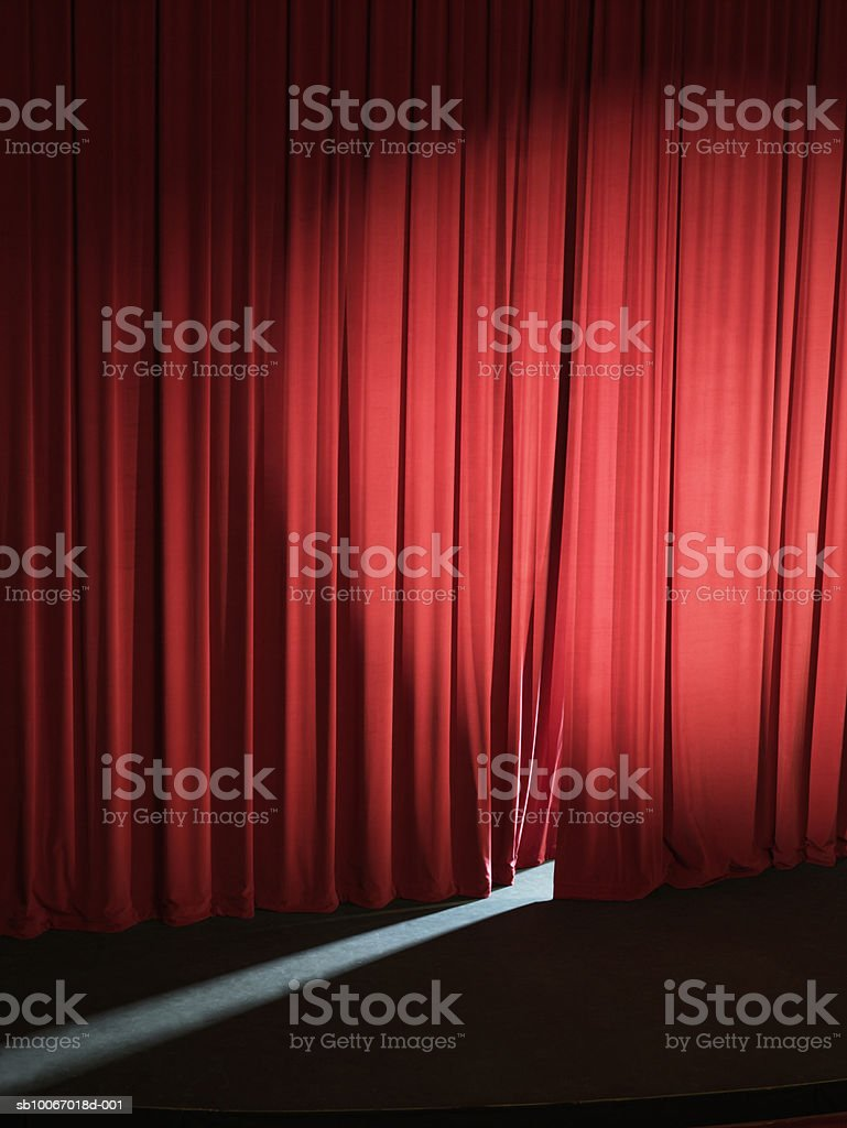 Empty stage with curtains slightly open letting light through royalty-free stock photo