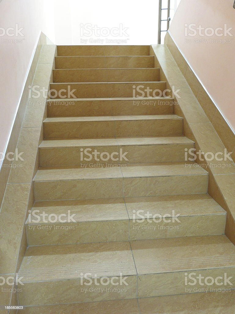 Empty stairway with tiled floor royalty-free stock photo