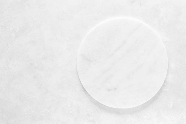 Empty stone board on white background with space for text, culinary background, top view stock photo