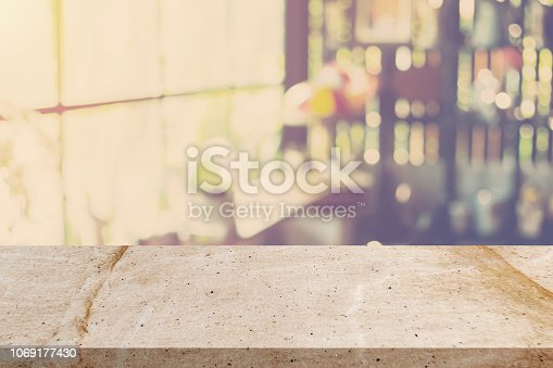 istock Empty stone marble and Blurred background : Coffee shop blur background bokeh with space display montage for product. 1069177430