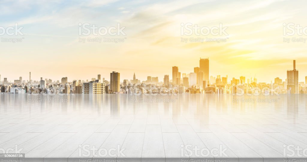 empty stone panel ground with panoramic city skyline aerial view under bright sun and blue sky of Tokyo, Japan stock photo