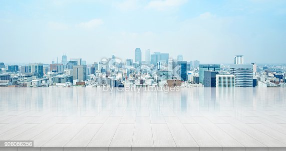 istock empty stone panel ground with panoramic city skyline aerial view under bright sun and blue sky of nagoya, Japan 926086256