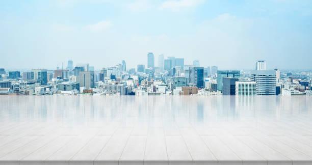 シティビュー パノラマ スカイライン空中明るい太陽と名古屋市の青い空の下で空の石パネル接地 - 街 日本 ストックフォトと画像