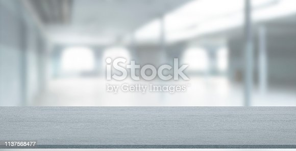 Empty stone table with blurred soft light factory business background. product display template. Mock up template for display. Business presentation.