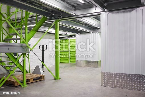513948652 istock photo Empty storage room 1204003439