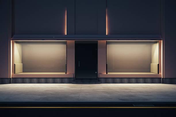 empty storefront at nighttime - facade shop 3d - fotografias e filmes do acervo