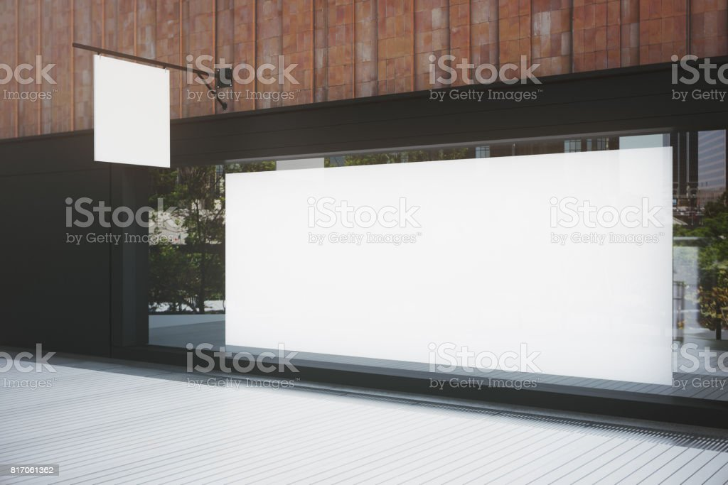 Empty storefront with billboard stock photo
