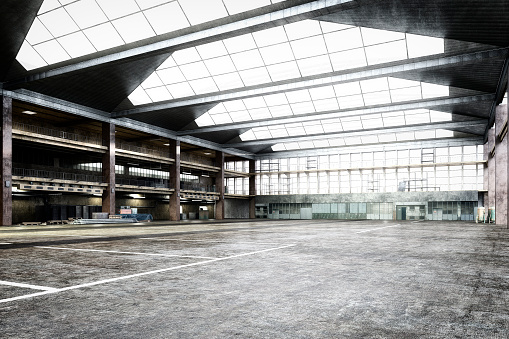 Empty storehouse interior iluminated by spotlights and natural light from roof windows. 3D rendered image.
