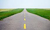 Empty straight asphalt road for background