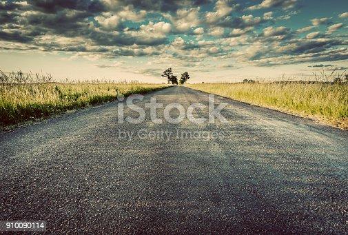 Empty straight long asphalt road. Dramatic cloudy sky. Concepts of travel, adventure, destination, transport etc. Vintage style