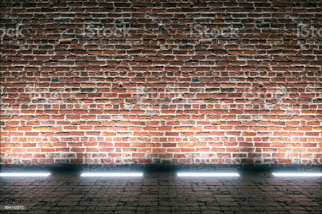 Empty street brick wall at night stock photo