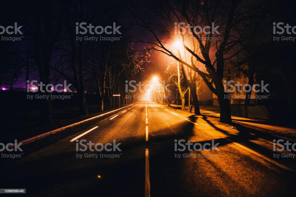 Empty street by night stock photo
