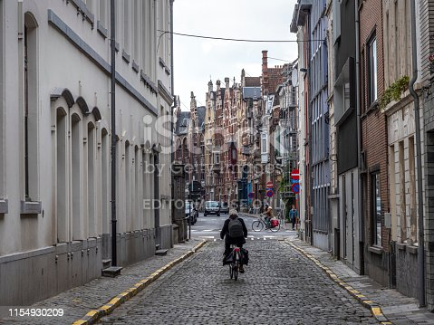 people are walking and cycling at street  in ghent belgium