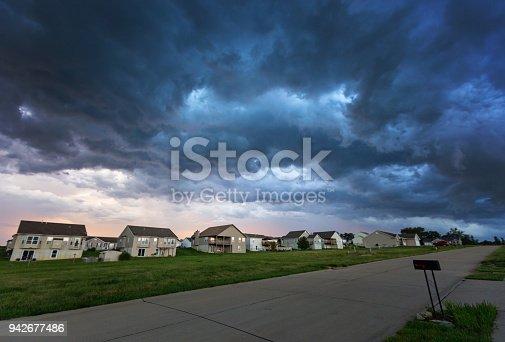 516351793 istock photo Empty Street in Summer Storm 942677486