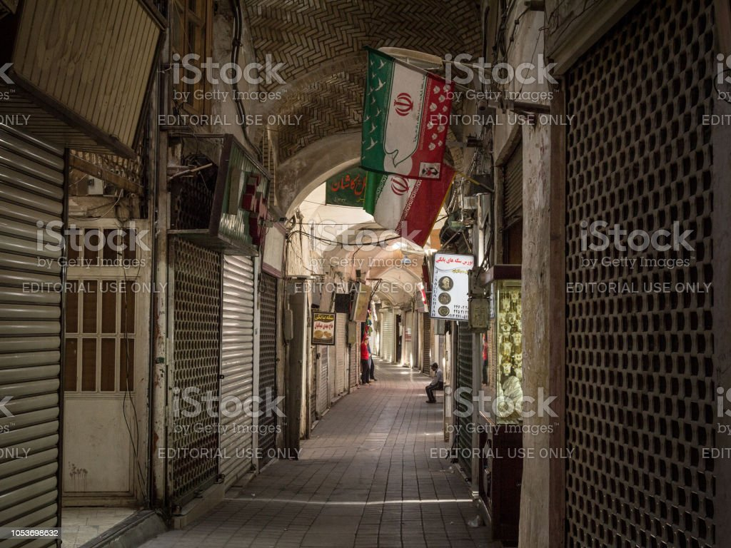 Empty street of the Kashan main bazar in the afternoon in a covered alley of the market. Symbol of the Persian architecture, it's a major landmark of the city stock photo