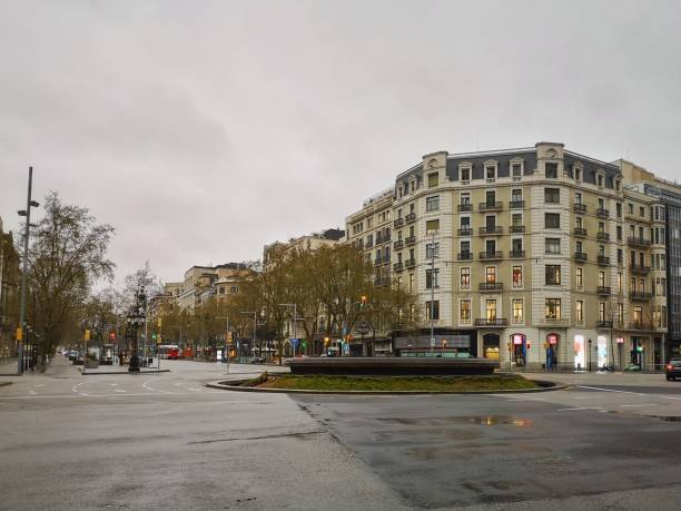 Empty street passeig de gracia in Barcelona, spain Barcelona, Spain - March 16, 2020: Empty street of Barcelona, Passeig de Gràcia in March 2020 passeig de gracia stock pictures, royalty-free photos & images
