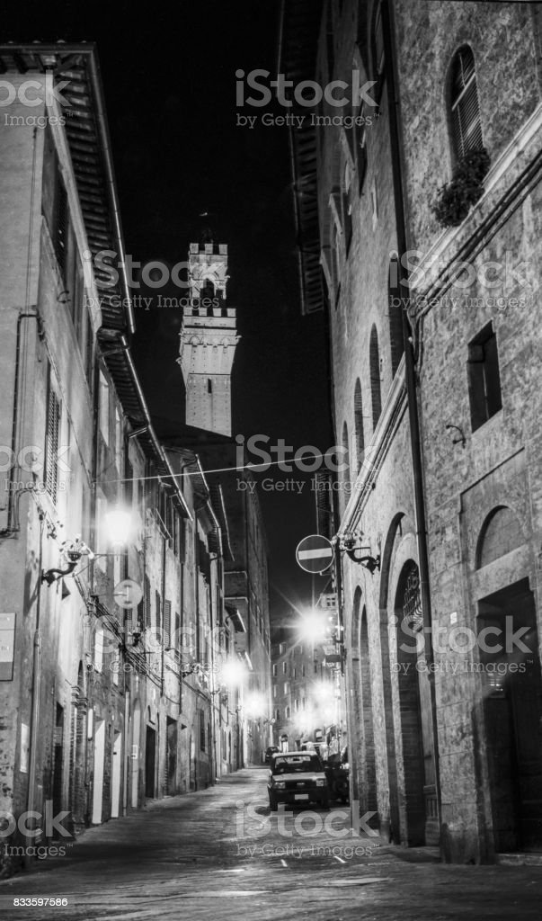 An empty street late at night in Siena., Italy.