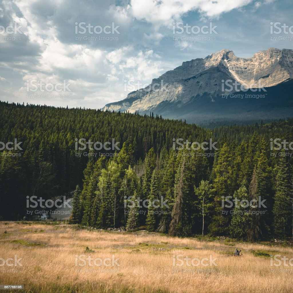 empty street with mountain panorama in banff national park cana