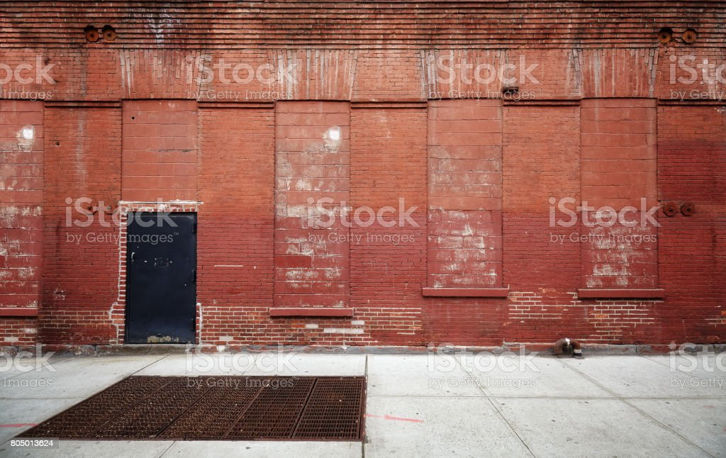Empty street with old warehouse brick wall. - foto stock