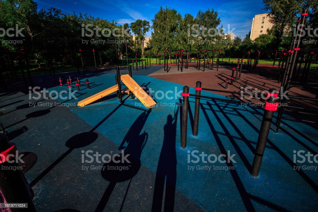 Empty street workout place in summer morning. City sport recreation...