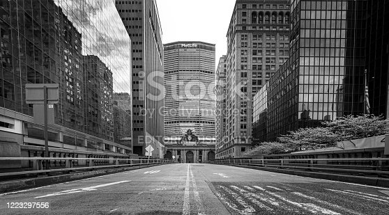 Manhattan, New York, USA - May 3, 2020: Street view of Grand Central Terminal from a normally busy Park Avenue, now empty and no traffic due to the lockdown from Covid-19 pandemic.