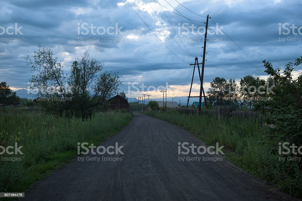 Empty streets of the remote village Kozyrevsk at sunset stock photo