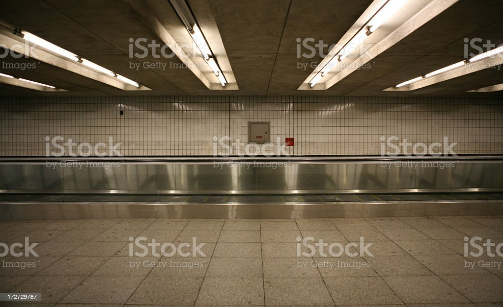 Empty subway station with fluorescent lights stock photo