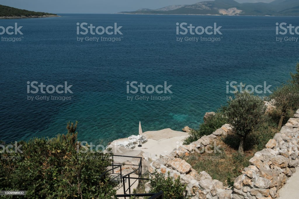 Empty sun loungers near the sea. Travel, Tourism and Recreation