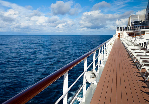 empty sun loungers on deck of ship - cruise ship stock photos and pictures