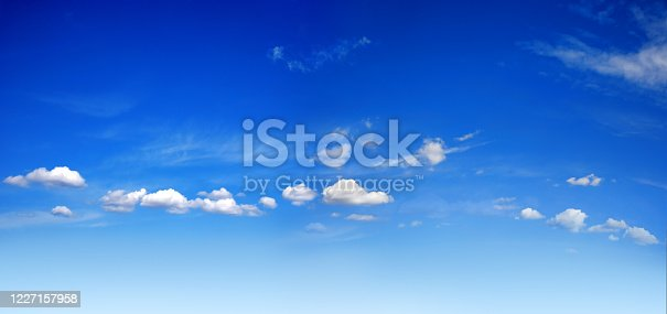 background image of sunny blue sky with white clouds