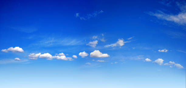 empty sunny blue sky with white clouds stock photo