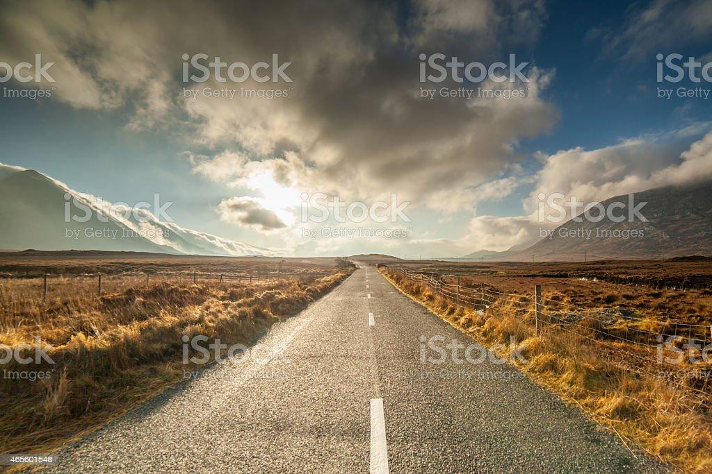 Empty Sunrise road in Connemara stock photo