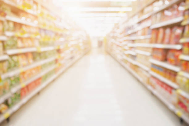 Empty Supermarket aisle shelves abstract blur defocused business background Empty Supermarket aisle shelves abstract blur defocused business background market retail space stock pictures, royalty-free photos & images
