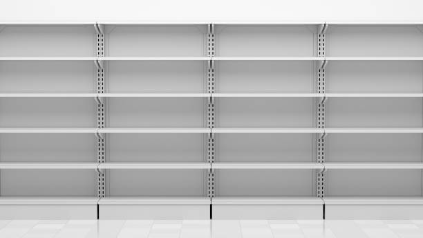 empty supermarket shelves in front of white wall stock photo
