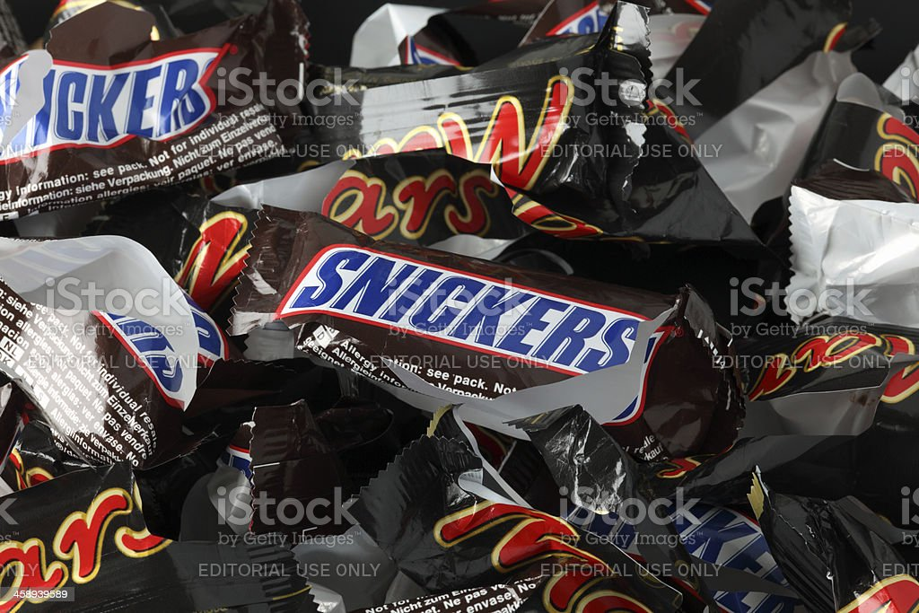 Empty sweet wrappers of Snickers and Mars candy bars stock photo