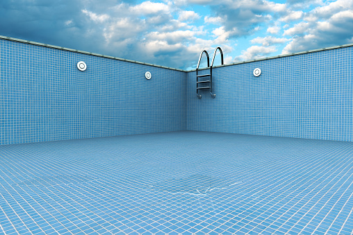 3D rendering of an empty swiming pool with the last drop of water.