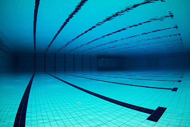 empty swimming pool underwater - competition group stock photos and pictures