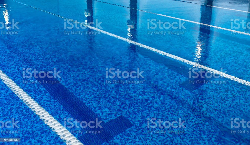 Empty swimming pool with clean blue water stock photo