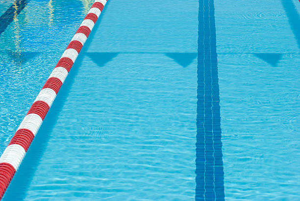 Empty Swimming Pool With Red & White Lane Line Marker stock photo