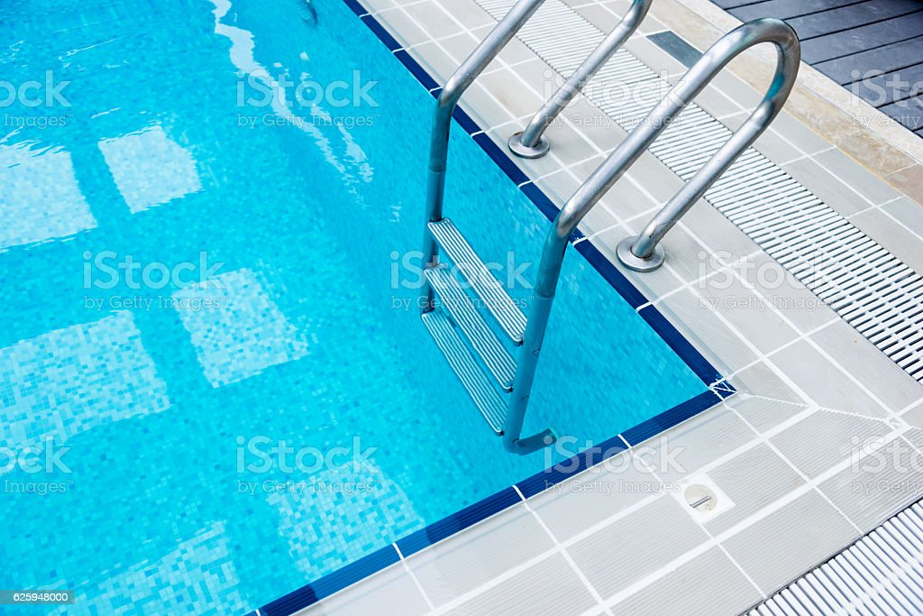 Empty swimming pool with steps stock photo
