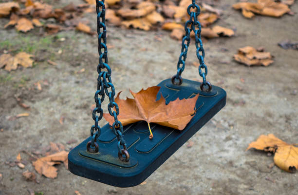Empty swing at the park stock photo