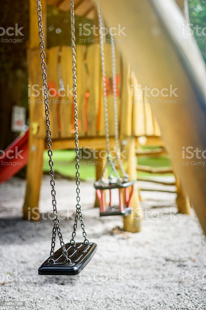 Empty Swing on Children Playground photo libre de droits