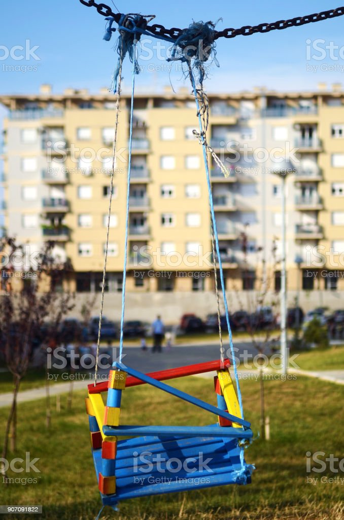 Empty swings in the playground stock photo