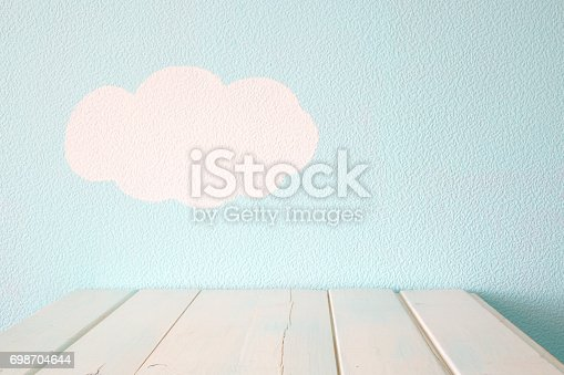 istock Empty table and blue wall 698704644