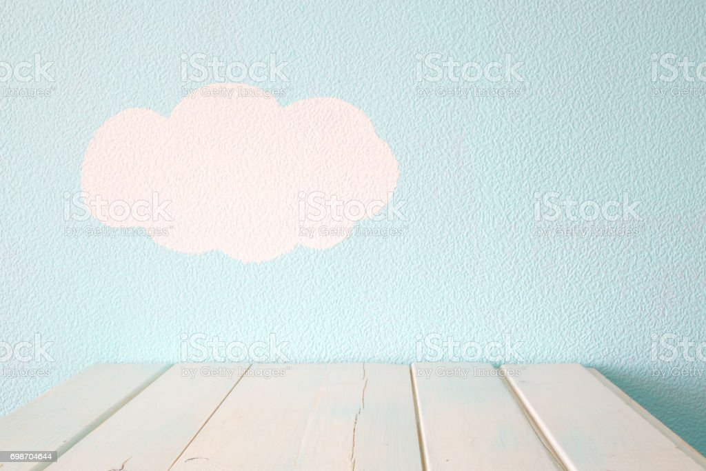 Empty table and blue wall stock photo