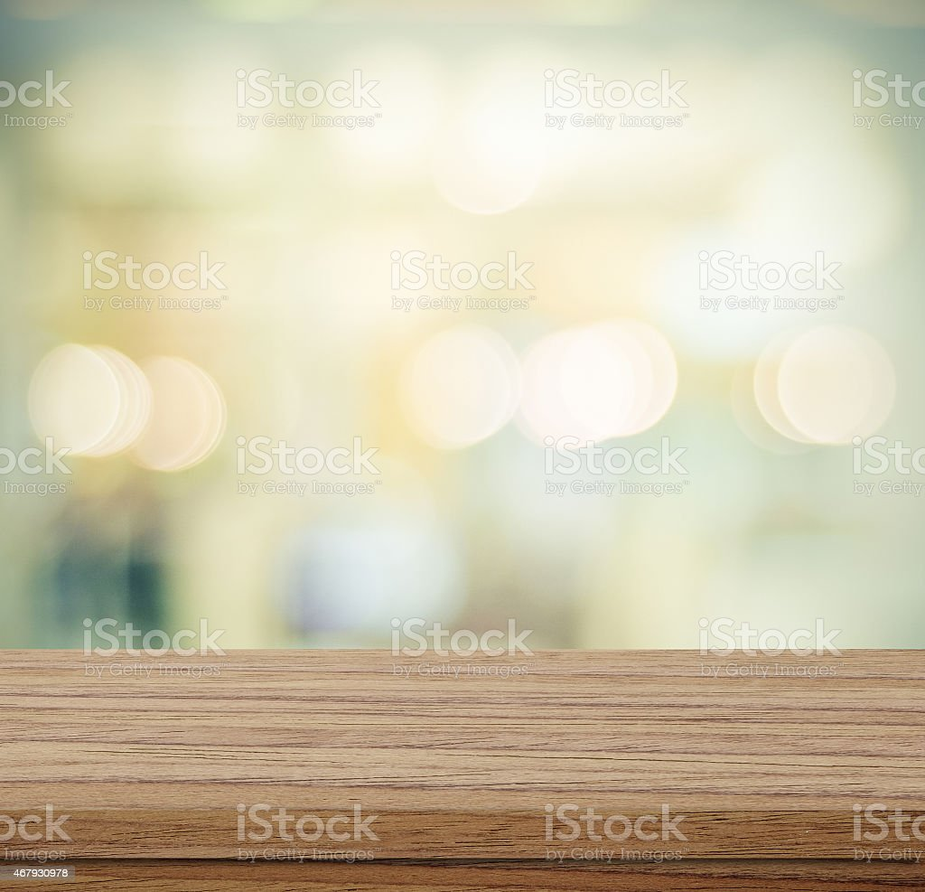 Empty table and blurred abstract background with bokeh stock photo